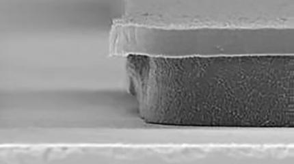 SEM showing a TechniEtch AC35 Etchant undercut at 3µm on the left to the competitor's POR at 14µm on the right.